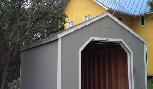 wooden storage shed with overhead door mini garage