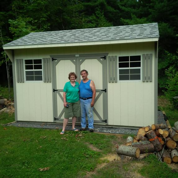 Happy customers in front of their new Quaker shed