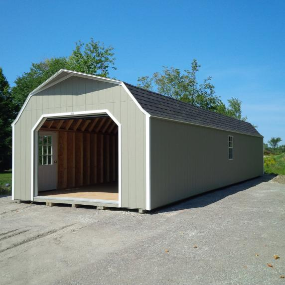 grey open door gambrel roof garage in Belleville, ON