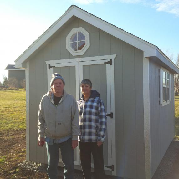 couple in front of their cape cod shed