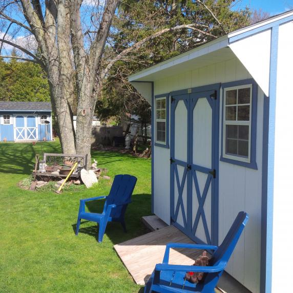 White and blue trimmed Quaker shed