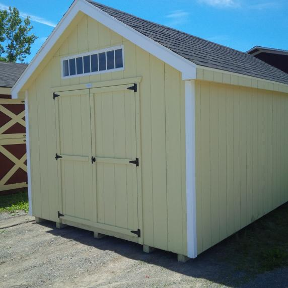 Beige cape cod shed