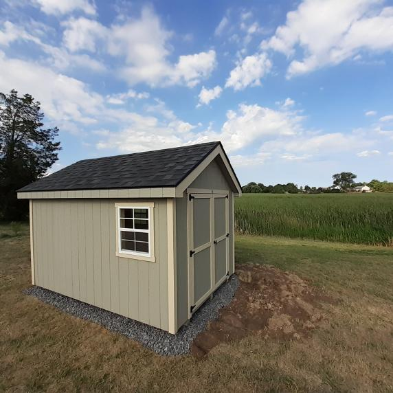 Cape Cod shed on gravel